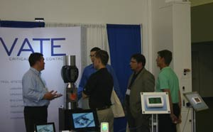 Picture of attendees visiting a booth